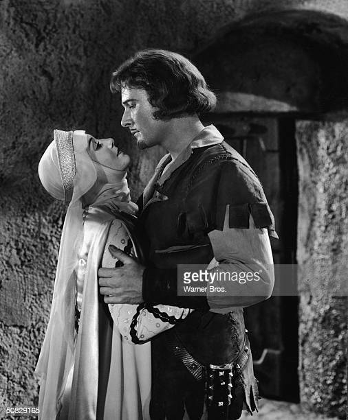 Actors Errol Flynn and Olivia de Havilland embrace in a still from 'The Adventures of Robin Hood' directed by Michael Curtiz and William Keighley 1938
