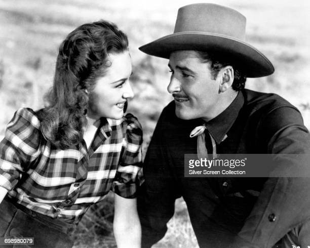 Actors Errol Flynn as Wade Hatton and Olivia de Havilland as Abbie Irving in the western 'Dodge City' 1939