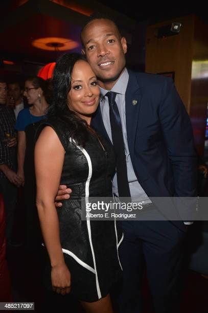 Actors Essence Atkins and Marlon Wayans attend the after party for the premiere of Open Road Films' A Haunted House 2 at on April 16 2014 in Los...