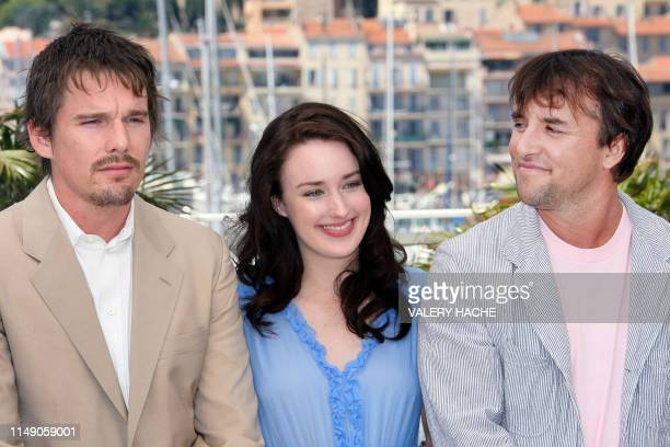 US actors Ethan Hawke and Ashley Johnson pose with director Richard Linklater during a photocall for their film 'Fast Food Nation' at the 59th...