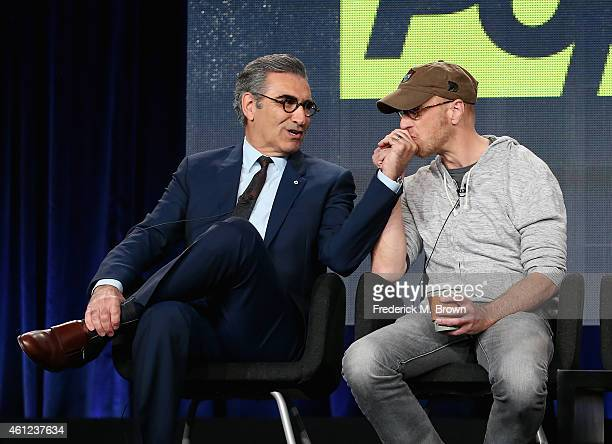 Actors Eugene Levy and Chris Elliott speak onstage during the 'Schitt's Creek' panel at the Pop Network portion of the 2015 Winter Television Critics...