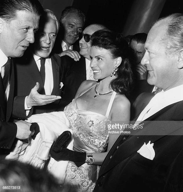 Actors Eva Bartock and Curd Jurgens chatting to other guests at the Cannes Film Festival May 11th 1957
