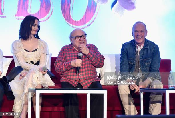 Actors Eva Green Danny DeVito and Michael Keaton speak onstage during the Dumbo Global Press Conference at The Beverly Hilton Hotel on March 10 2019...