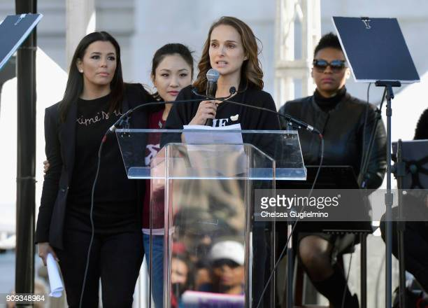 Actors Eva Longoria Constance Wu and Natalie Portman speak during the Women's March Los Angeles 2018 on January 20 2018 in Los Angeles California