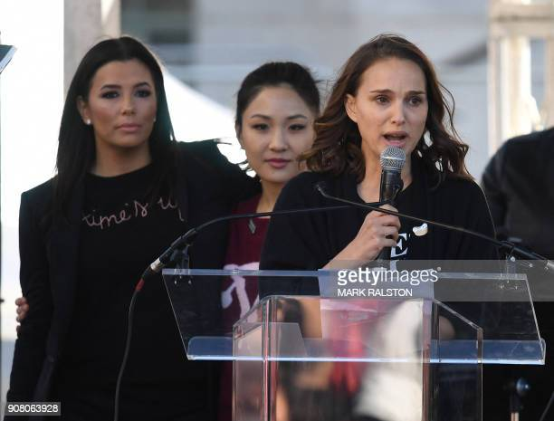 TOPSHOT Actors Eva Longoria Constance Wu and Natalie Portman speak to the 500000 strong crowd during the Women's Rally on the oneyear anniversary of...