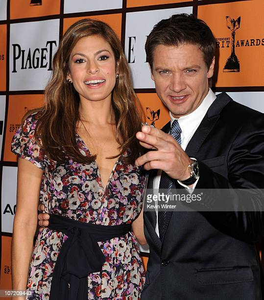 Actors Eva Mendes and Jeremy Renner pose onstage during the 2011 Film Independent Spirit Award nominations press conference at The London West...