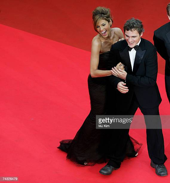 Actors Eva Mendes and Joaquin Phoenix arrive at the premiere for the film 'We Own The Night' at the Palais des Festivals during the 60th...