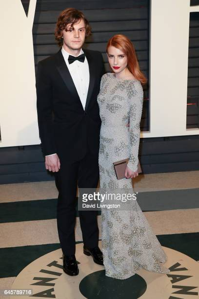 Actors Evan Peters and Emma Roberts attend the 2017 Vanity Fair Oscar Party hosted by Graydon Carter at the Wallis Annenberg Center for the...
