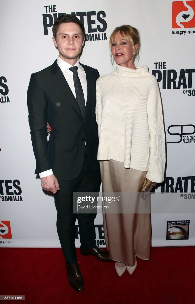 Actors Evan Peters (L) and Melanie Griffith attend the premiere of Front Row Filmed Entertainment's 'The Pirates of Somalia' at TCL Chinese 6 Theatres on December 6, 2017 in Hollywood, California.