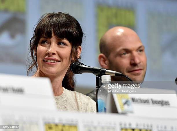 Actors Evangeline Lilly and Corey Stoll onstage at Marvel's Hall H Panel for AntMan during ComicCon International 2014 at San Diego Convention Center...