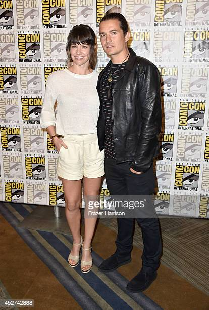 Actors Evangeline Lilly and Orlando Bloom attend The Hobbit The Battle Of The Five Armies Press Line during ComicCon International 2014 at Hilton...