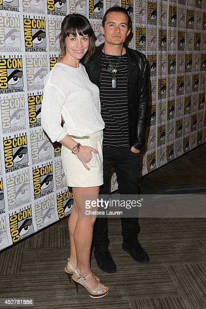 Actors Evangeline Lilly and Orlando Bloom attend'The hobbit' press room on July 26 2014 in San Diego California