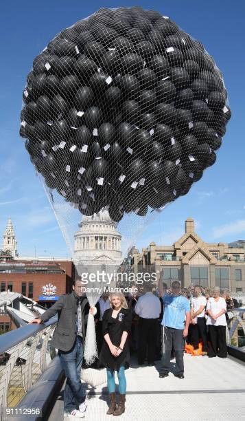Actors Evanna Lynch and Matthew Lewis release 1000 balloons on the Millennium Bridge to mark the DVD release of Harry Potter And The HalfBlood Prince...