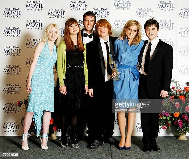 Actors Evanna Lynch Bonnie Wright Matthew Lewis Rupert Grint Emma Watson and Daniel Radcliffe pose in the awards room with the Best Family Film award...