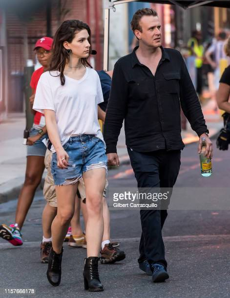 Actors Eve Lindley and Jason Segel are seen filming on set of AMC's Dispatches from Elsewhere an upcoming American anthology television series...