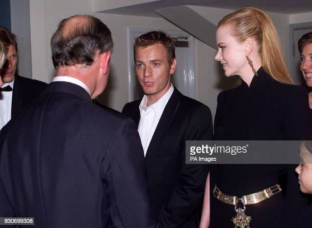 Actors Ewan McGregor and Nicole Kidman with Prince Charles at the premiere of Moulin Rouge