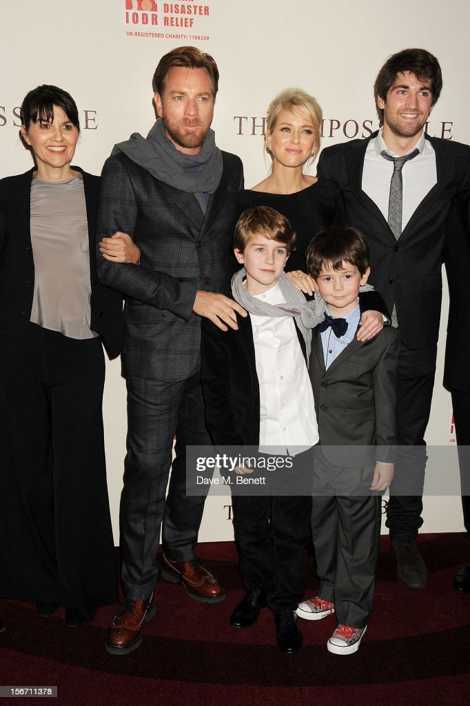 Actors Ewan McGregor, Naomi Watts, Samuel Joslin and Oaklee Pendergast pose with Spanish tsunami survivors Maria Belon (L) and son Lucas Belon (R) at the UK charity premiere of 'The Impossible' at BFI IMAX on November 19, 2012 in London, England.
