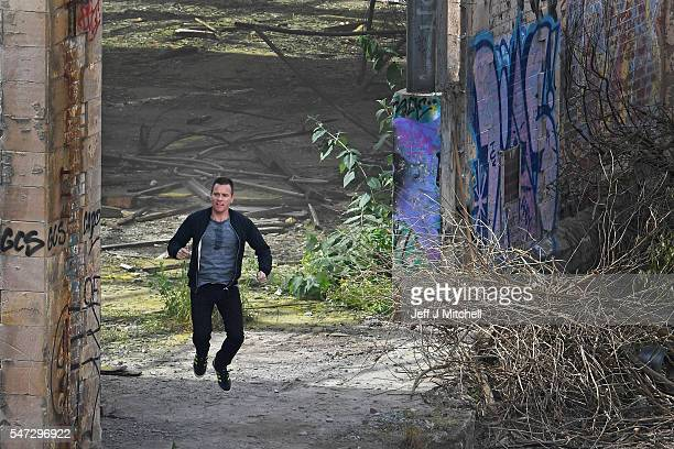 Actors Ewan McGregor on the set of the Trainspotting film sequel in a disused warehouse in Leith on July 14 2016 in Edinburgh Scotland The long...