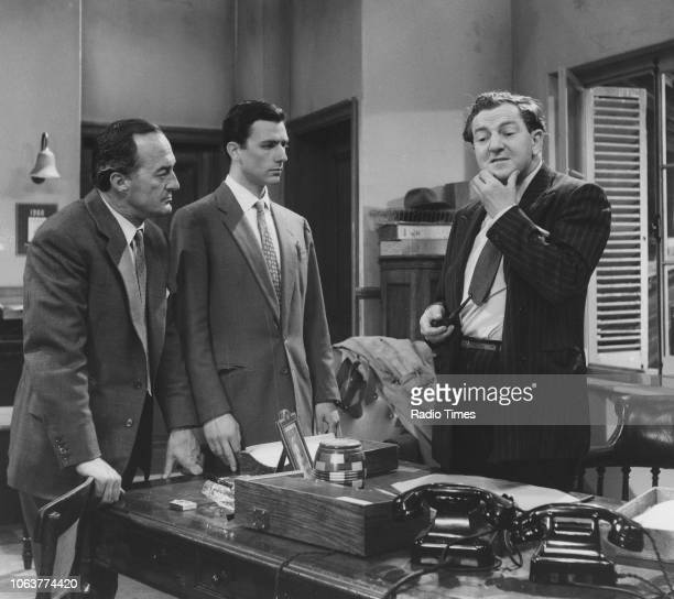 Actors Ewen Solon Neville Jason and Rupert Davies in a scene from the television show 'Maigret' June 14th 1960