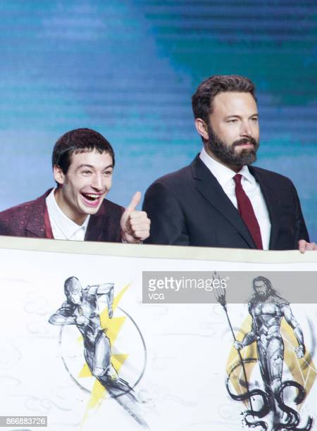 Actors Ezra Miller and Ben Affleck attend 'Justice League' premiere at 798 Art Zone on October 26 2017 in Beijing China