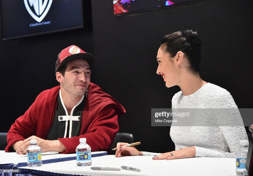 Actors Ezra Miller (L) and Gal Gadot during the 'Justice League' autograph signing at Comic-Con International 2017 at San Diego Convention Center on July 22, 2017 in San Diego, California.