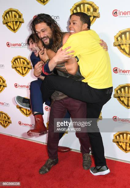 Actors Ezra Miller Jason Momoa and Ray Fisher arrive at CinemaCon 2017 Warner Bros Pictures Invites You to The Big Picture at The Colosseum at...