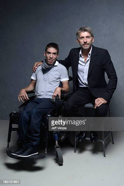 Actors Fabien Heraud and Jacques Gamblin of 'The Finishers' pose at the Guess Portrait Studio during 2013 Toronto International Film Festival on...