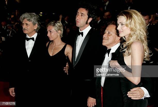 Actors Fabrizio Bentivoglio an unidentified guest Paolo Sorrentino Giacomo Rizzo and Laura Chiatti attend the 'L'Amico Di Famiglia' premiere during...