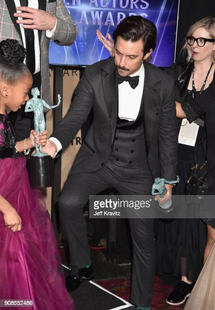 Actors Faithe Herman and Milo Ventimiglia pose in the press room during the 24th Annual Screen Actors Guild Awards at The Shrine Auditorium on...