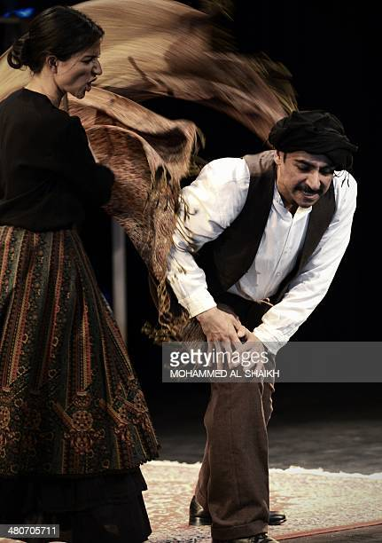 Actors Fanos Xenofs and Dina Mousawi perform during a play titled Rest Upon The Wind commemorating the life and times of legendary Lebanese poet and...