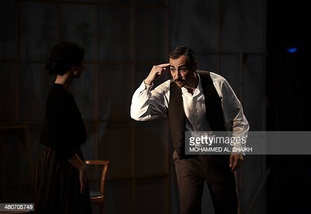 Actors Fanos Xenofs and Dina Mousawi perform in a play titled Rest Upon The Wind commemorating the life and times of legendary Lebanese poet and...