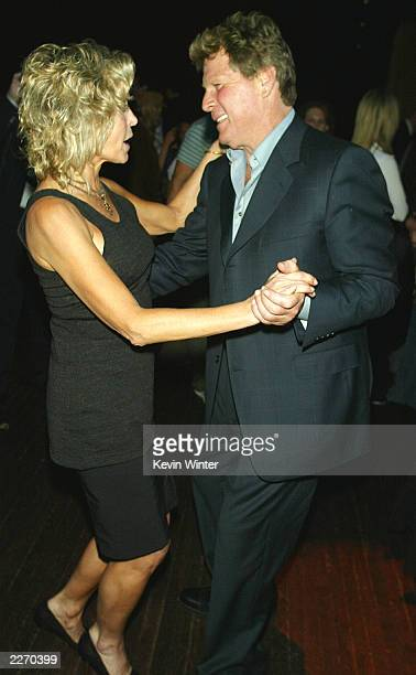 Actors Farrah Fawcett and Ryan O'Neal dance at the afterparty for 'Malibu's Most Wanted' at the Highlands on April 10 2003 in Los Angeles California