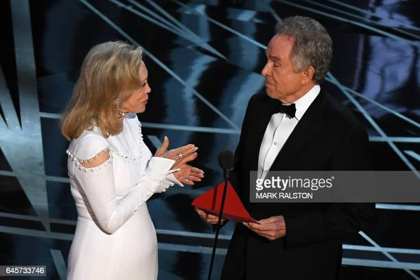 TOPSHOT US actors Faye Dunaway and Warren Beatty present on stage the Best Film award at the 89th Oscars on February 26 2017 in Hollywood California...