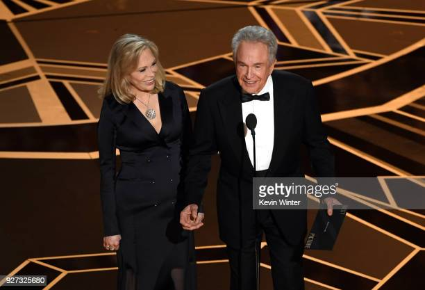 Actors Faye Dunaway and Warren Beatty speak onstage during the 90th Annual Academy Awards at the Dolby Theatre at Hollywood & Highland Center on...