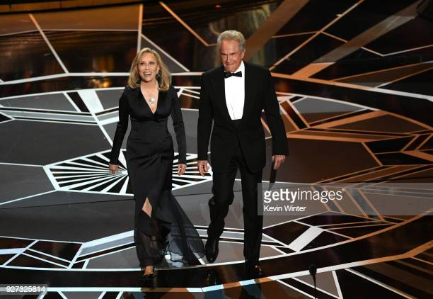 Actors Faye Dunaway and Warren Beatty walk onstage during the 90th Annual Academy Awards at the Dolby Theatre at Hollywood Highland Center on March 4...