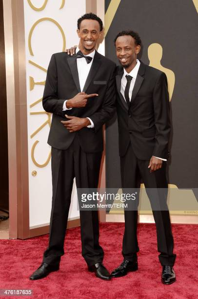 Actors Faysal Ahmed and Barkhad Abdi attend the Oscars held at Hollywood Highland Center on March 2 2014 in Hollywood California