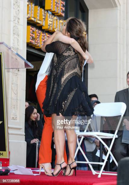 Actors Felicity Huffman and Eva Longoria attend the ceremony to honor Eva Longoria with a Star on The Hollywood Walk Of Fame on April 16 2018 in...
