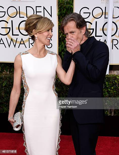 Actors Felicity Huffman and William H Macy attend the 72nd Annual Golden Globe Awards at The Beverly Hilton Hotel on January 11 2015 in Beverly Hills...