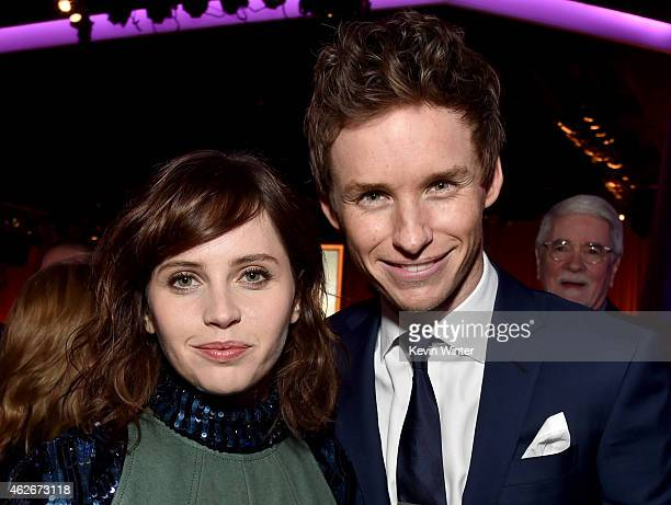 Actors Felicity Jones and Eddie Redmayne attend the 87th Annual Academy Awards Nominee Luncheon at The Beverly Hilton Hotel on February 2, 2015 in...