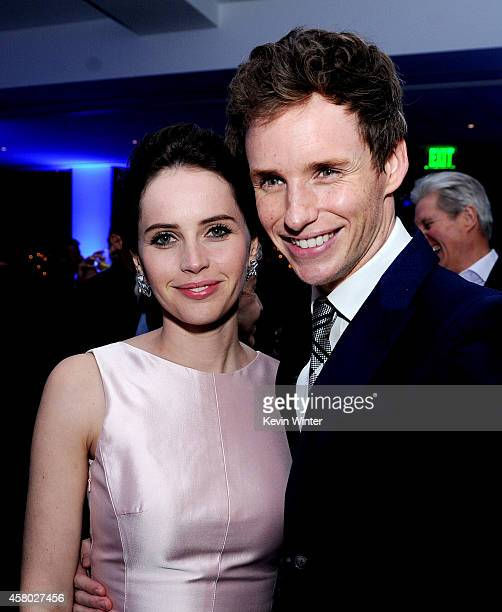 """Actors Felicity Jones and Eddie Redmayne pose at the after party for the premiere of Focus Features' """"The Theory Of Everything"""" at the Samuel Goldwyn..."""