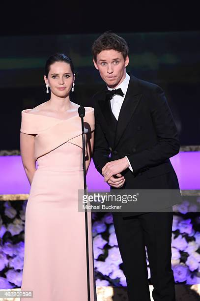 Actors Felicity Jones and Eddie Redmayne speak onstage during TNT's 21st Annual Screen Actors Guild Awards at The Shrine Auditorium on January 25...