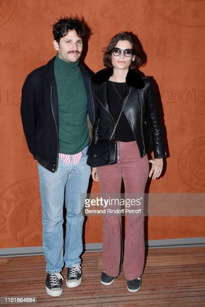 ACtors Felix de Givry and his companion Alma Jodorowsky attend the 2019 French Tennis Open Day One at Roland Garros on May 26 2019 in Paris France