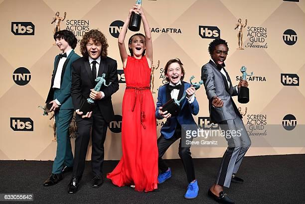 Actors Finn Wolfard Gaten Matarazzo Millie Bobby Brown Noah Schapp and Caleb McLaughlin winners of the Outstanding Ensemble in a Drama Series award...