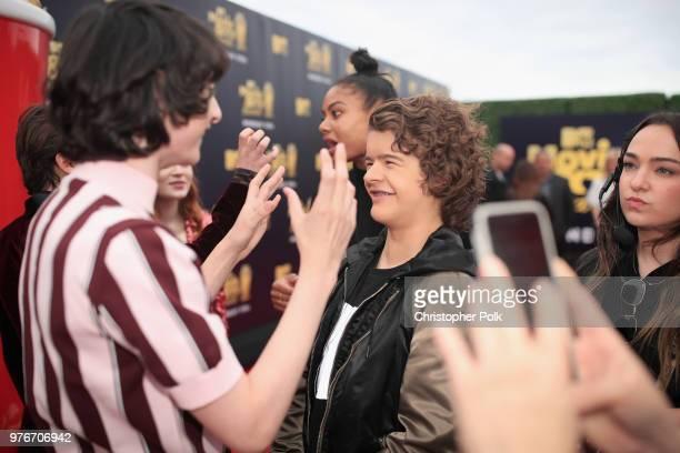 Actors Finn Wolfhard and Gaten Matarazzo attend the 2018 MTV Movie And TV Awards at Barker Hangar on June 16 2018 in Santa Monica California