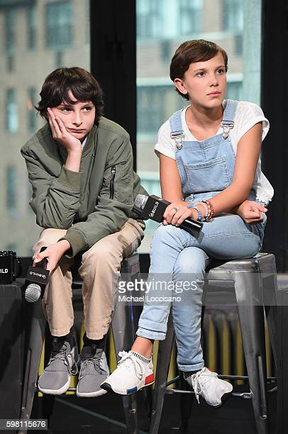 "Actors Finn Wolfhard and Millie Bobby Brown of ""Stranger Things"" attend the BUILD Series at AOL HQ on August 31, 2016 in New York City."