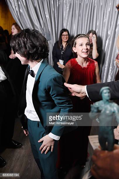 Actors Finn Wolfhard and Millie Bobby Brown winners of the Outstanding Ensemble in a Drama Series award of 'Stranger Things' in the trophy room...