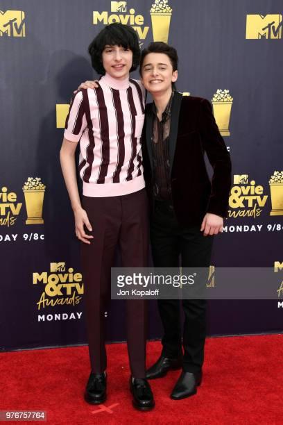 Actors Finn Wolfhard and Noah Schnapp attend the 2018 MTV Movie And TV Awards at Barker Hangar on June 16 2018 in Santa Monica California