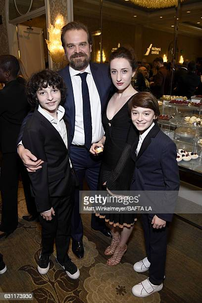 Actors Finn Wolfhard David Harbour and Noah Schnapp with guest attend The BAFTA Tea Party at Four Seasons Hotel Los Angeles at Beverly Hills on...