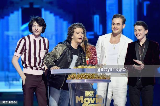 Actors Finn Wolfhard Gaten Matarazzo Sadie Sink Dacre Montgomery and Noah Schnapp speak onstage at the 2018 MTV Movie And TV Awards at Barker Hangar...