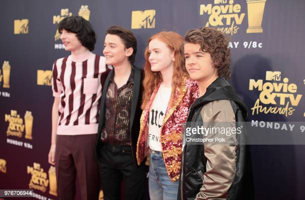 Actors Finn Wolfhard Noah Schnapp Sadie Sink and Gaten Matarazzo attend the 2018 MTV Movie And TV Awards at Barker Hangar on June 16 2018 in Santa...